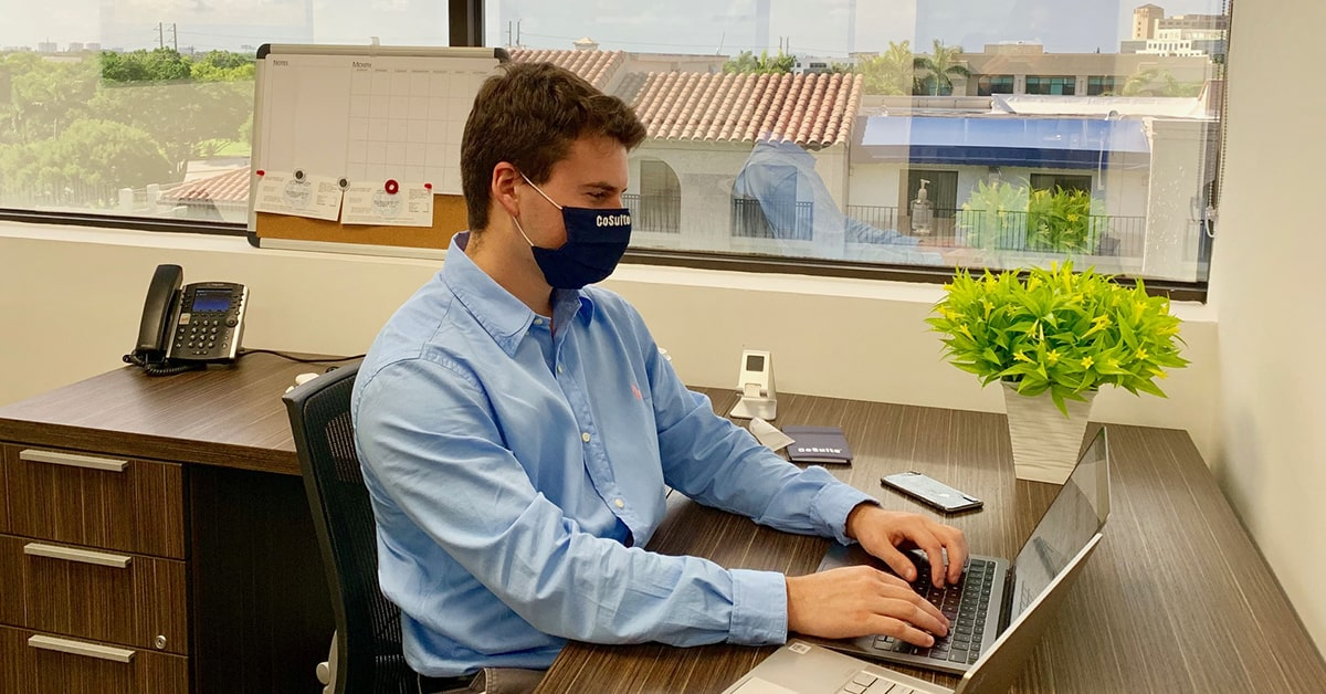 Employee Wearing CoSuite Mask